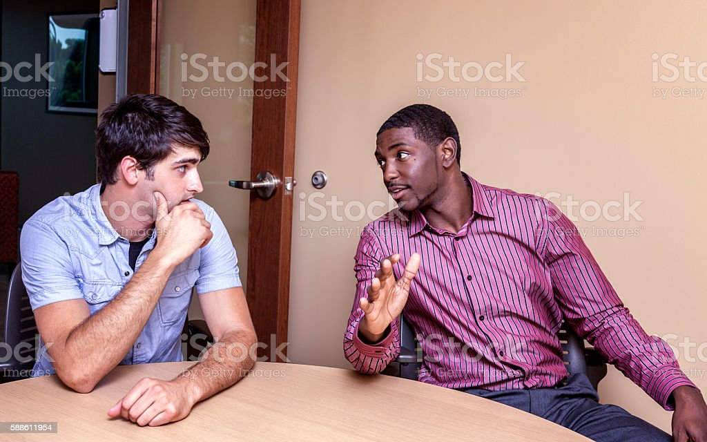 Two Multi-Ethnic Guys Conference Room Meeting Conversation stock photo