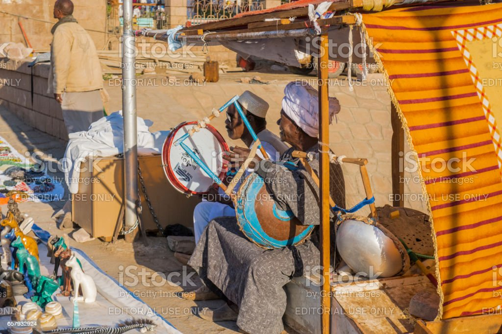 Two musicians playing at Assuan Port, Egypt. stock photo