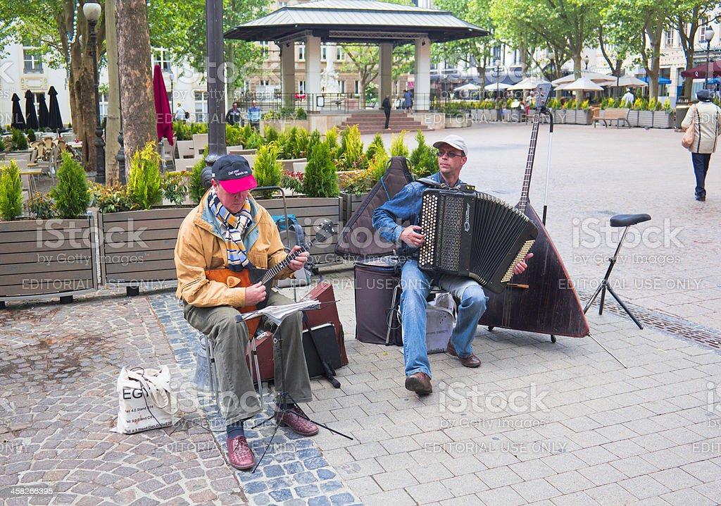 Two musicians playing the balalaika and accordion stock photo