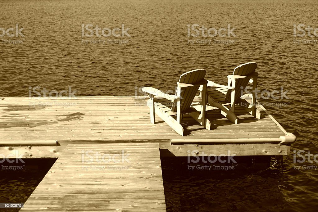 Two Muskoka Chairs on the Dock royalty-free stock photo