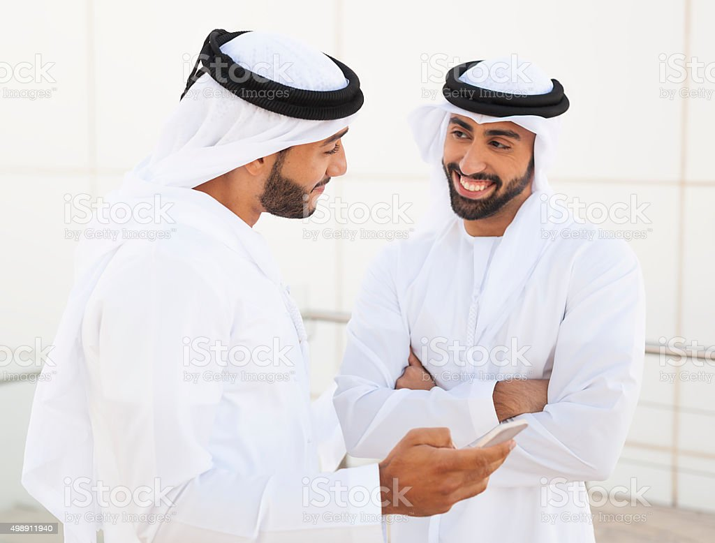 Two Muslim Business Partners Outside Office Building stock photo