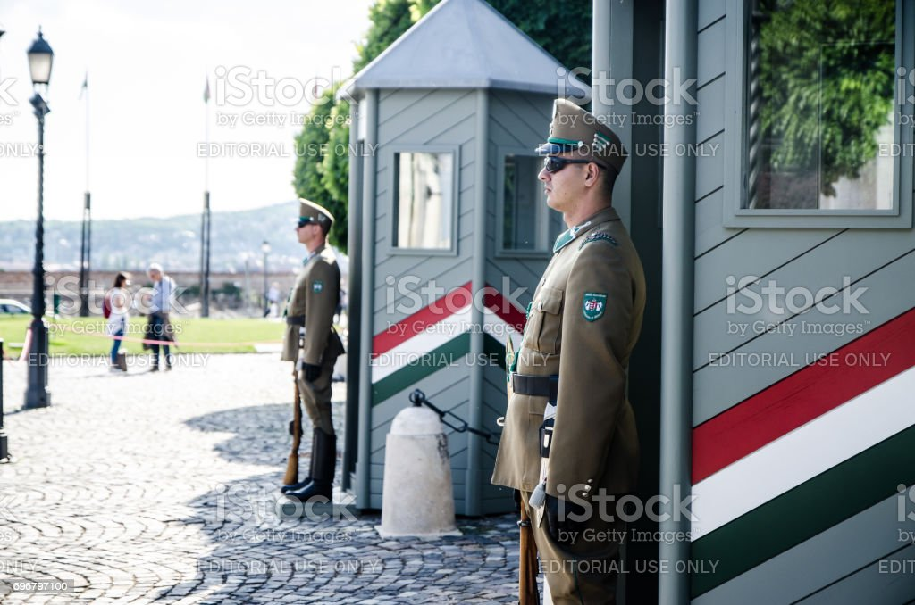 Two national guards standing in front of their booth stock photo