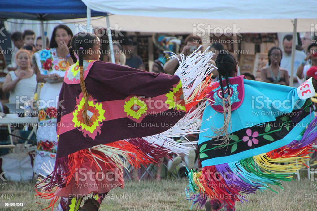 Two Native American girls dancing at pow-wow stock photo