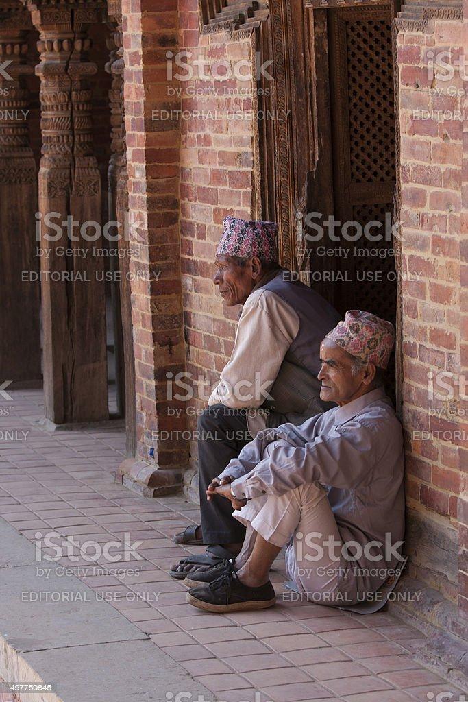 Two Nepalese men sitting in Durbar Square, Patan, Nepal stock photo