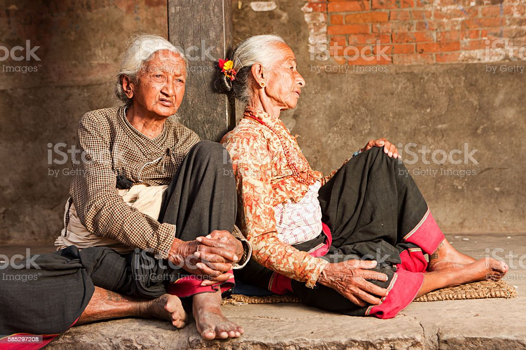 Two Nepali ladies resting on Durbar Square in Bhaktapur, Nepal stock photo