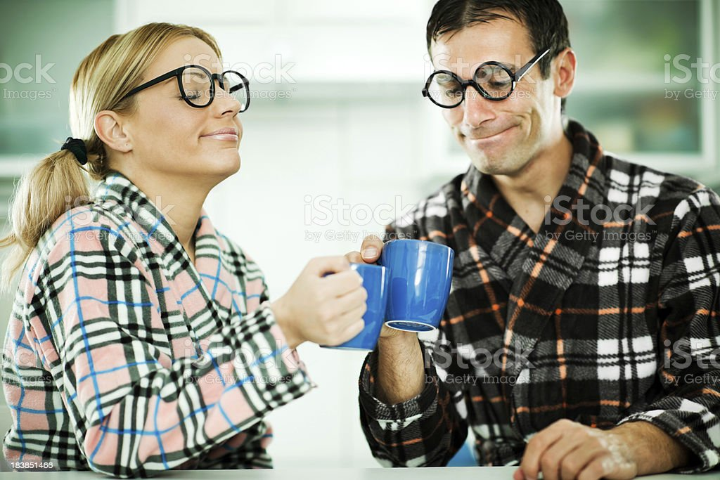 Two nerds drinking tea from their mugs. royalty-free stock photo