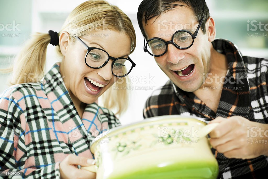 Two nerds looking at the saucepan. royalty-free stock photo