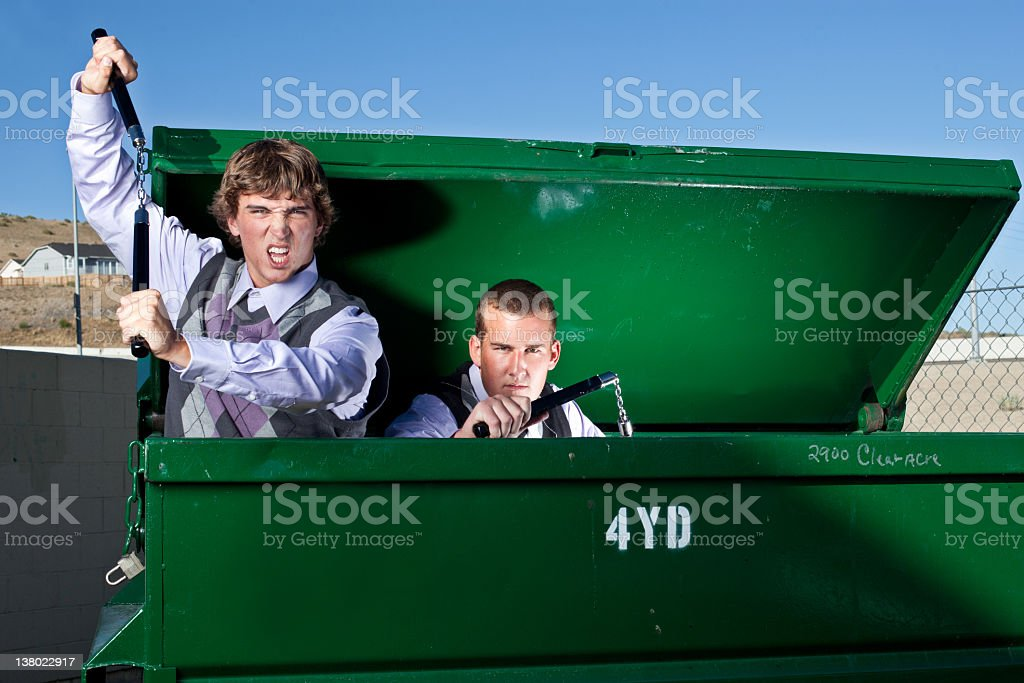 Two nerds with nunchuks. royalty-free stock photo