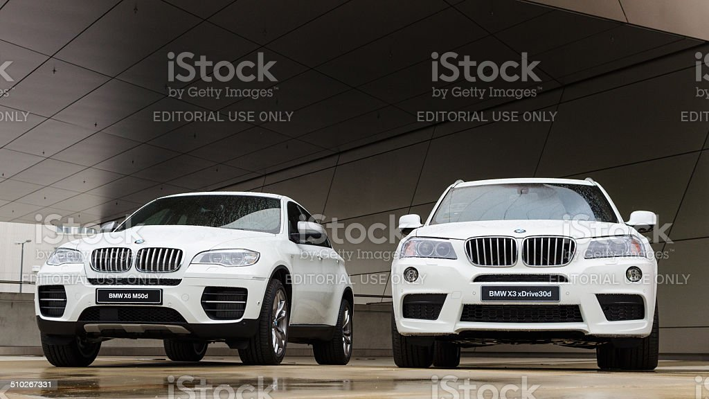 Two new white BMW X3 and X6 powerful SUV cars stock photo