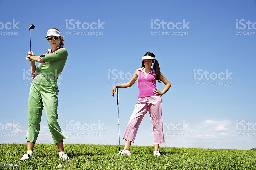 Two newbie golfers royalty-free stock photo