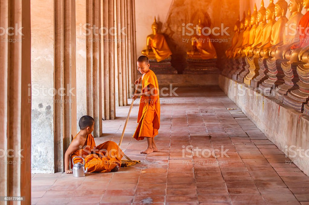 Two novices playing with funny in old temple stock photo