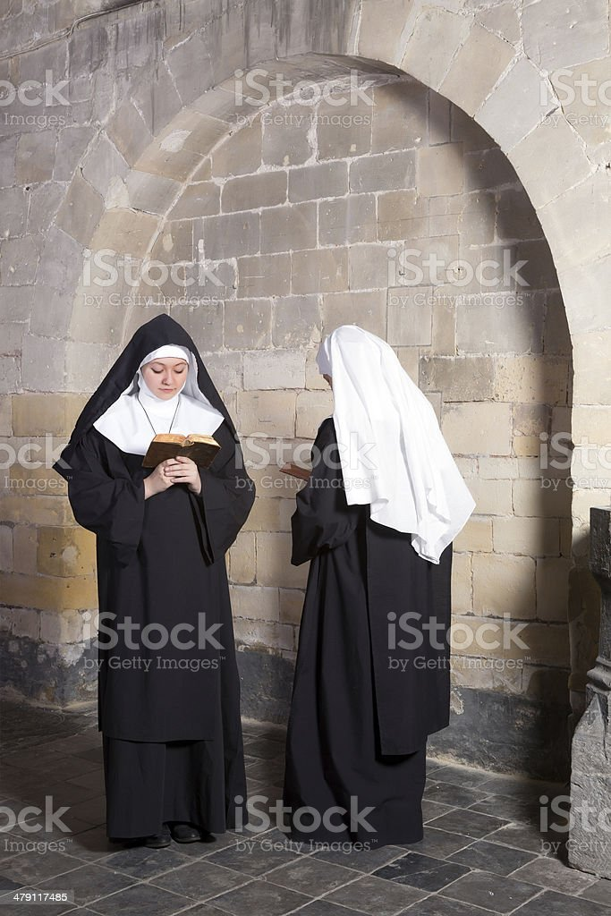 Two nuns in an old convent stock photo