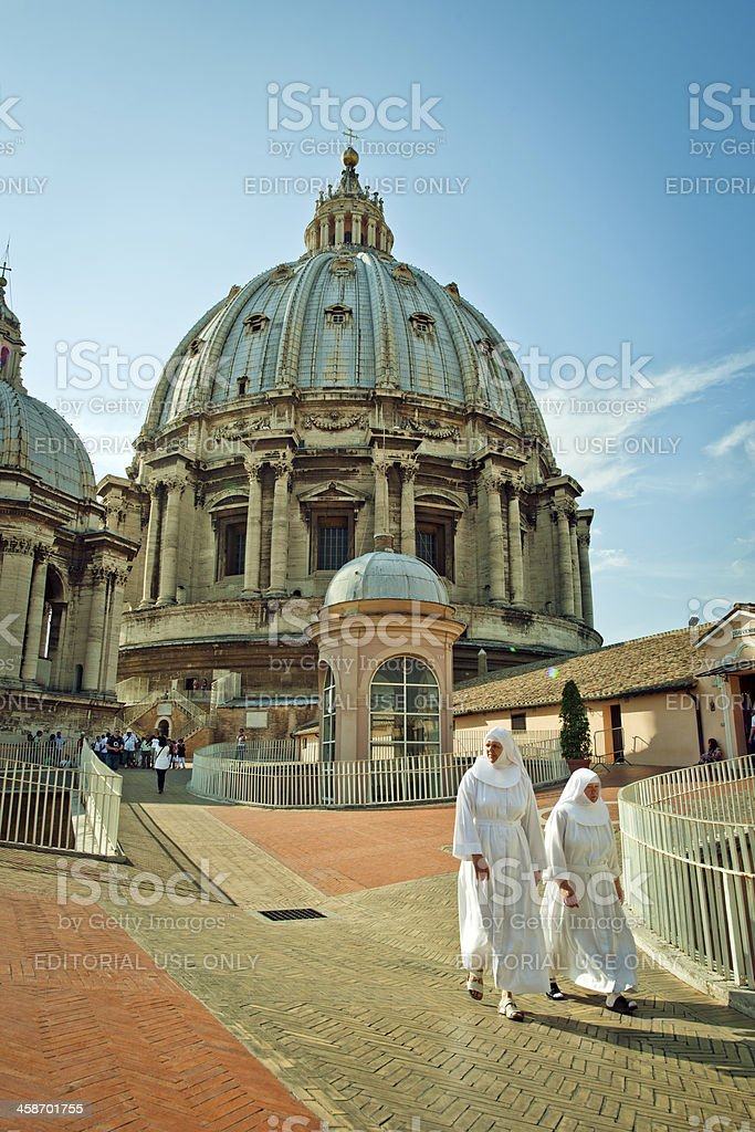 Two nuns walking on the roof of St. Peter's Cathedral royalty-free stock photo