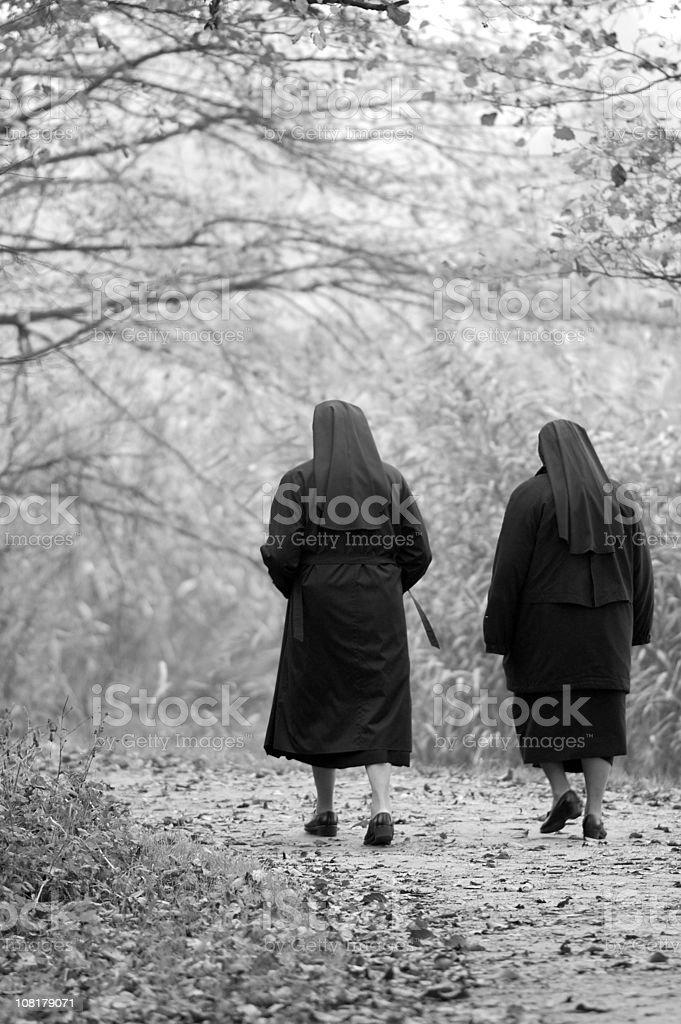 Two Nuns Walking Through Park, Black and White stock photo