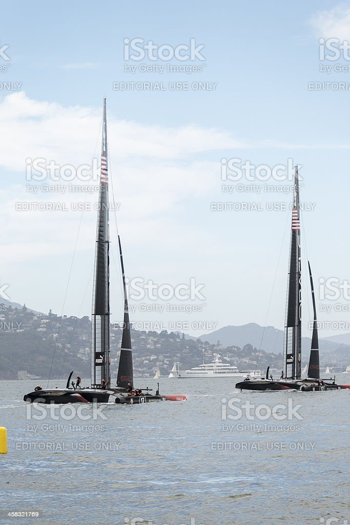 Two of Team Oracle's 72 foot America's Cup catamaran training stock photo