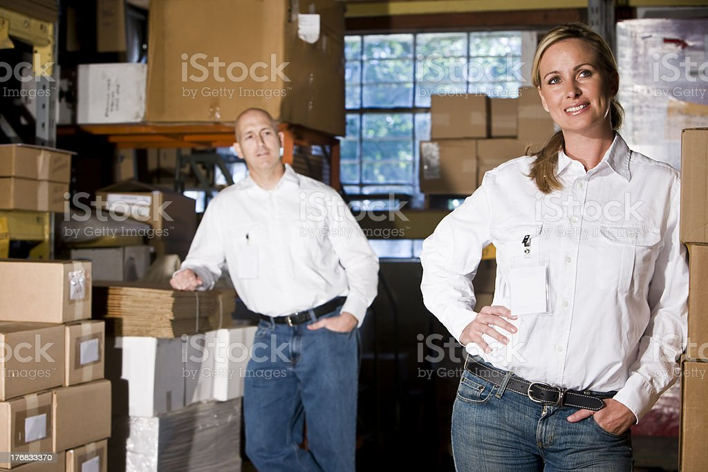 Two office coworkers in storage warehouse royalty-free stock photo