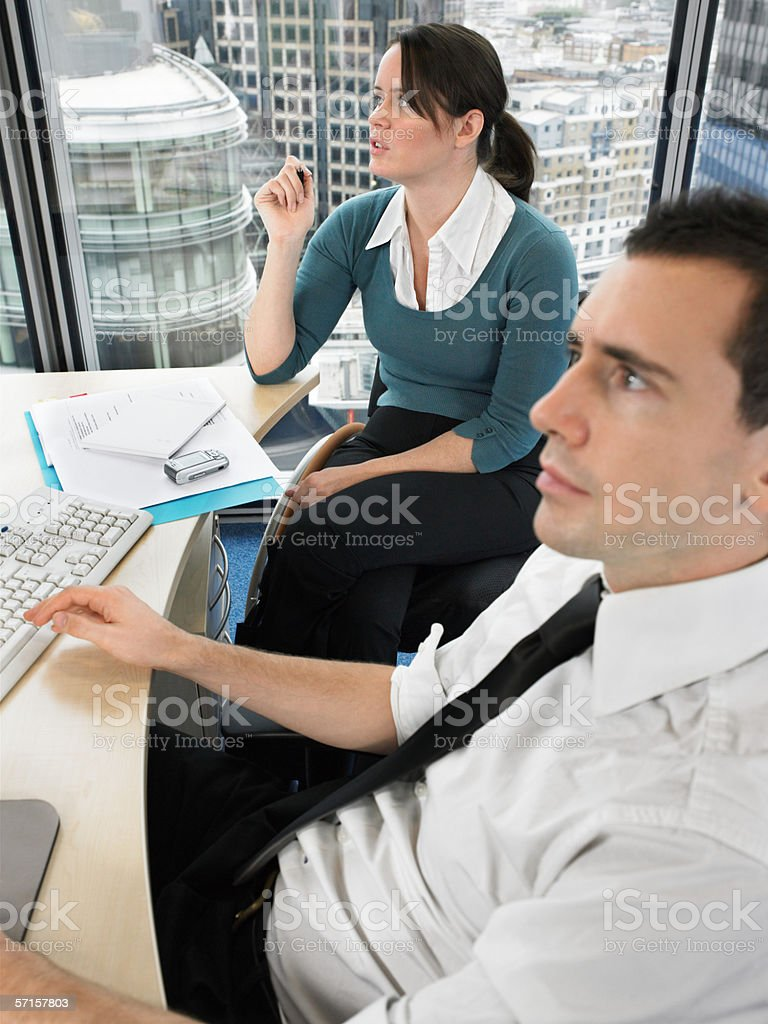 Two office workers in meeting stock photo