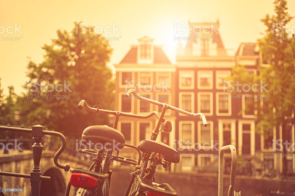 Two old bicycles in Amsterdam at sunset stock photo