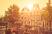 Two old bicycles in Amsterdam at sunset