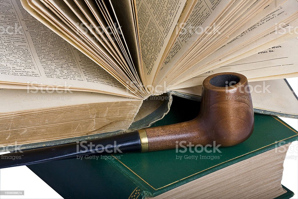 Two old books and a pipe stock photo