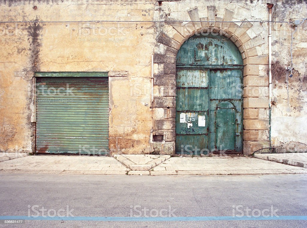 Two old building entrances: rectangular and arched stock photo