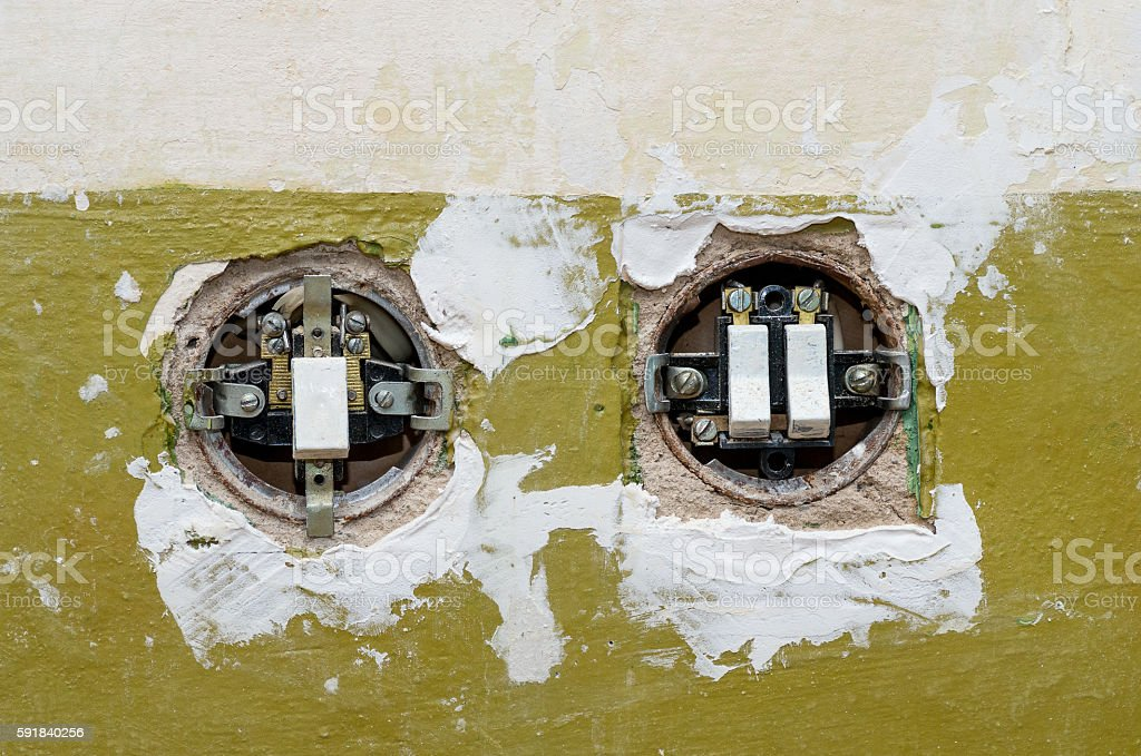 Two old electric switches mounted in the wall stock photo