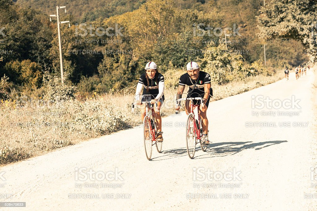 Two old fashioned cyclists during l'Eroica cycling race stock photo
