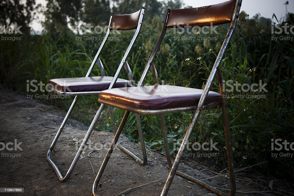 Two old Folding Chairs stock photo
