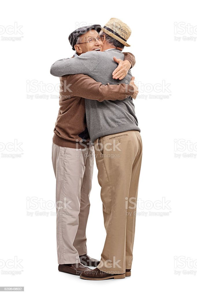 Two old friends hugging each other stock photo