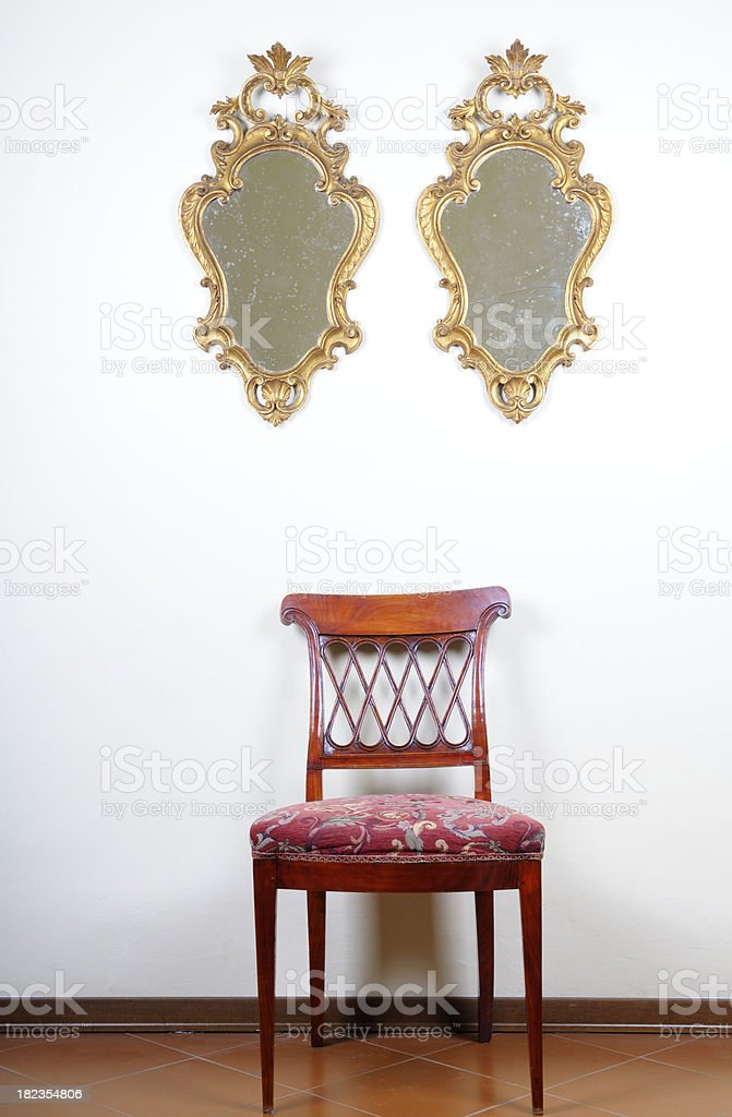 Two Old Gold Mirrors and Vintage Chair royalty-free stock photo