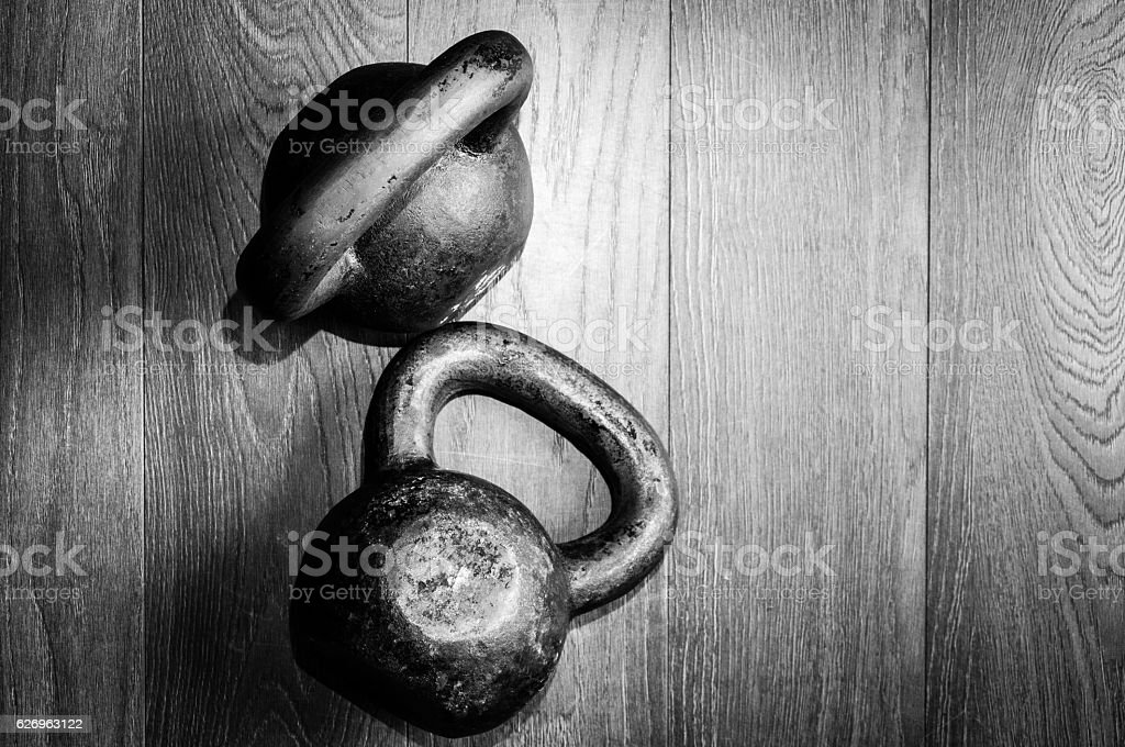 Two old kettle bell on the gy floor. stock photo