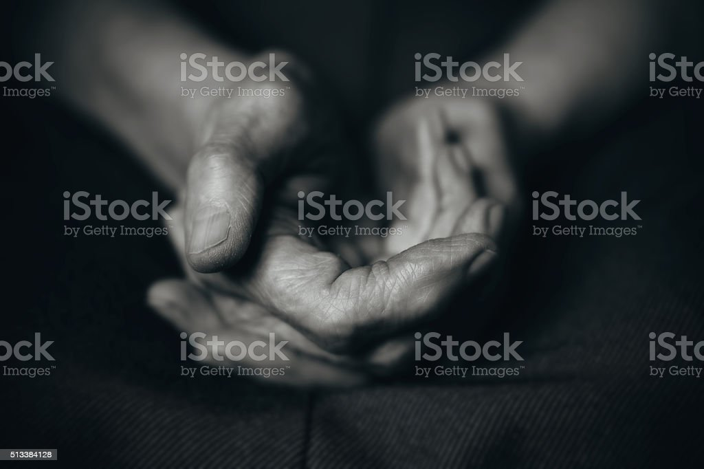 Two old man's hands stock photo