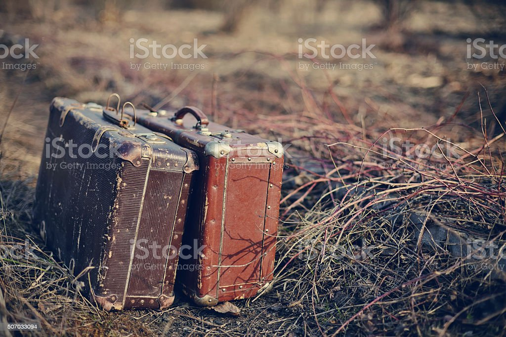 Two old shabby suitcases stock photo