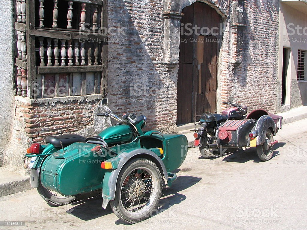 Two old side-cars in Camaguey, Cuba stock photo