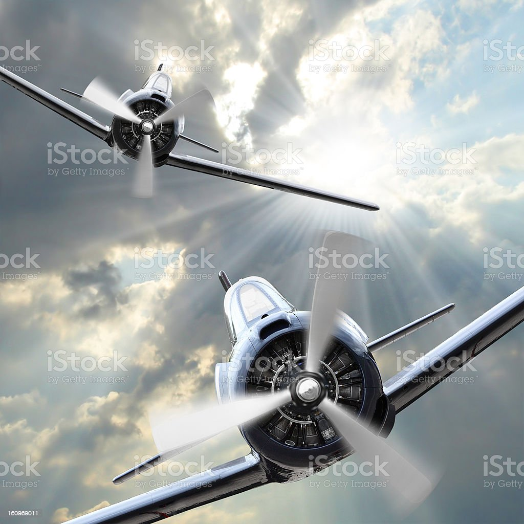 Two old style fighter jets flying with each other royalty-free stock photo