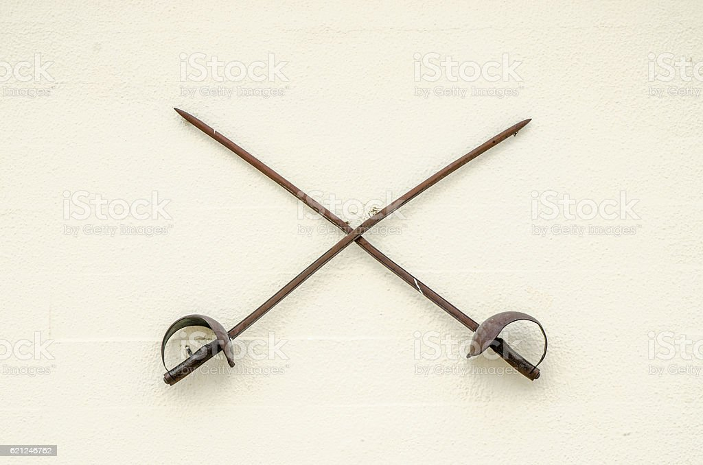 Two old swords on a wall stock photo