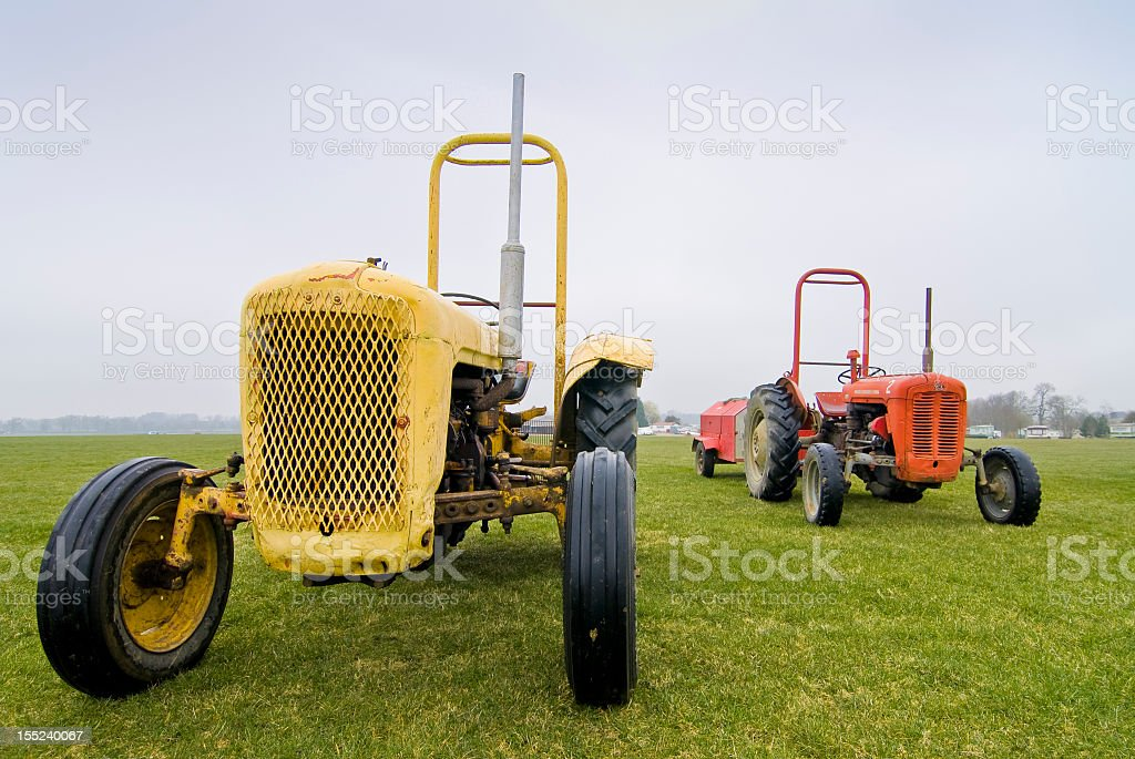 Two old tractors from 50s stock photo