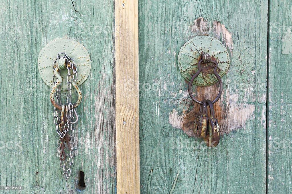 two old village door handle doorknocker green wood Cyprus royalty-free stock photo