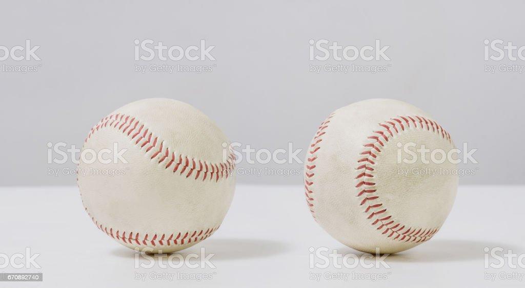 two old white baseball on white background