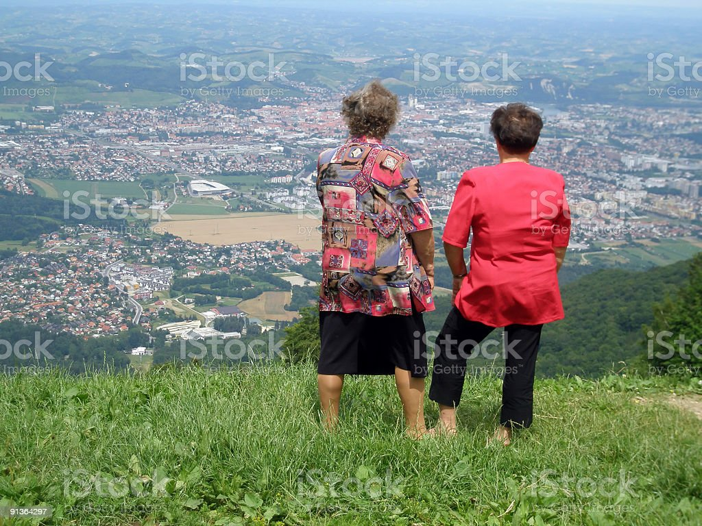 Two old woman loking down on the valley royalty-free stock photo