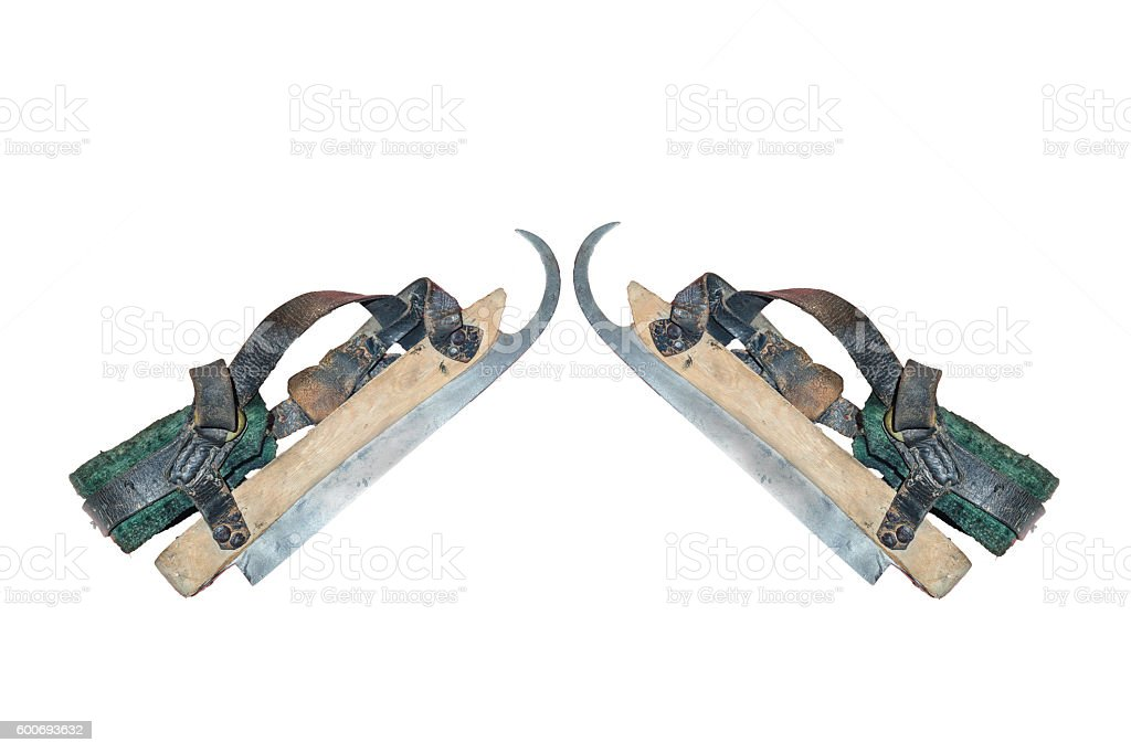 Two old wooden ice skates stock photo