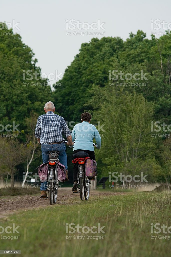 Two older cyclists royalty-free stock photo