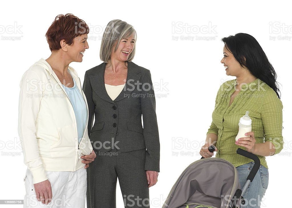 Two older women chat with a new mother pushing a stroller. royalty-free stock photo