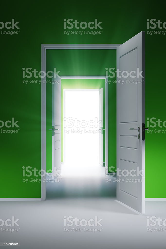 Two open doors with beams of light pouring in stock photo