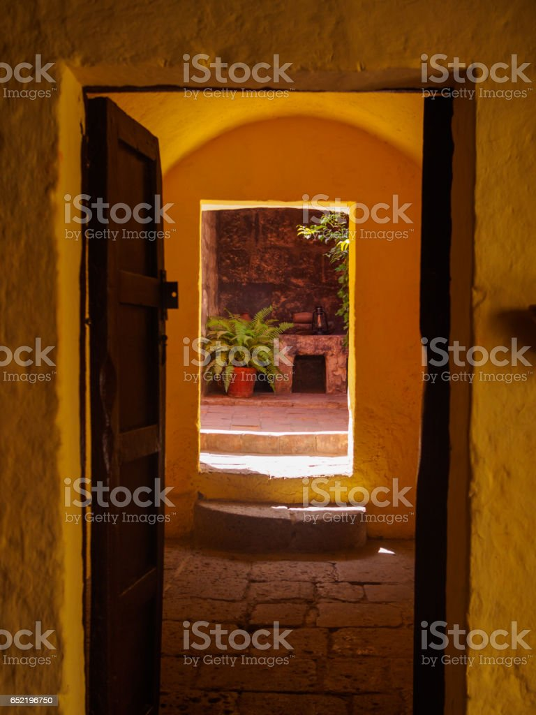 Two open doors with patio at the background in Santa Catalina convent of Arequipa stock photo