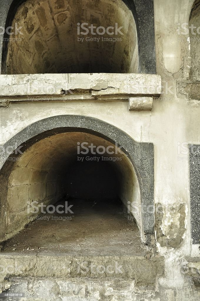 Two open tombs in a church catacomb royalty-free stock photo