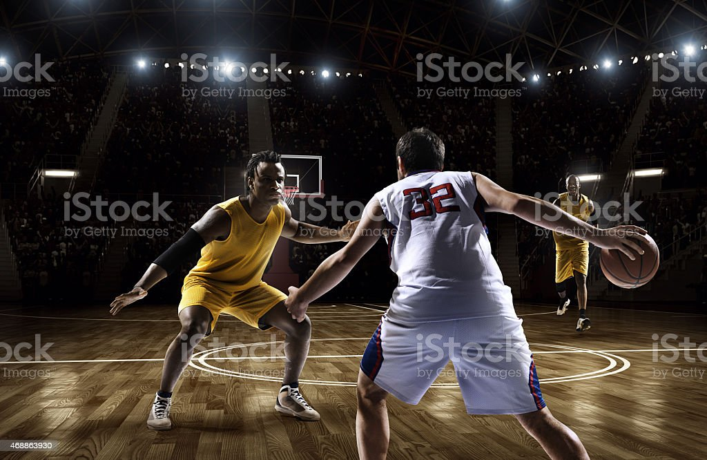 Two opposing basketball players facing each other stock photo