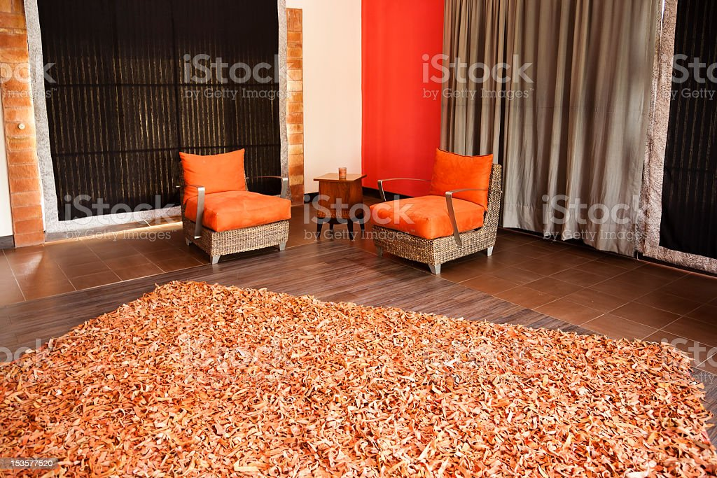 Two orange armchairs in a modern apartment royalty-free stock photo