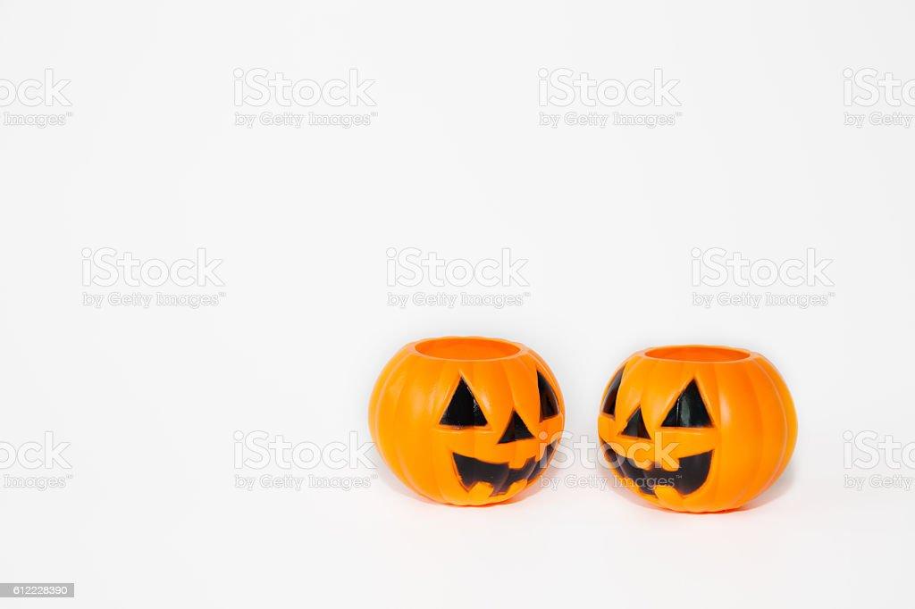 Two orange jack-o-lantern bucket pumpkins in white background stock photo