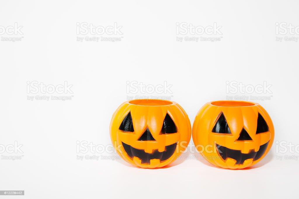 Two orange jack-o-lantern bucket pumpkins in white isolated back stock photo